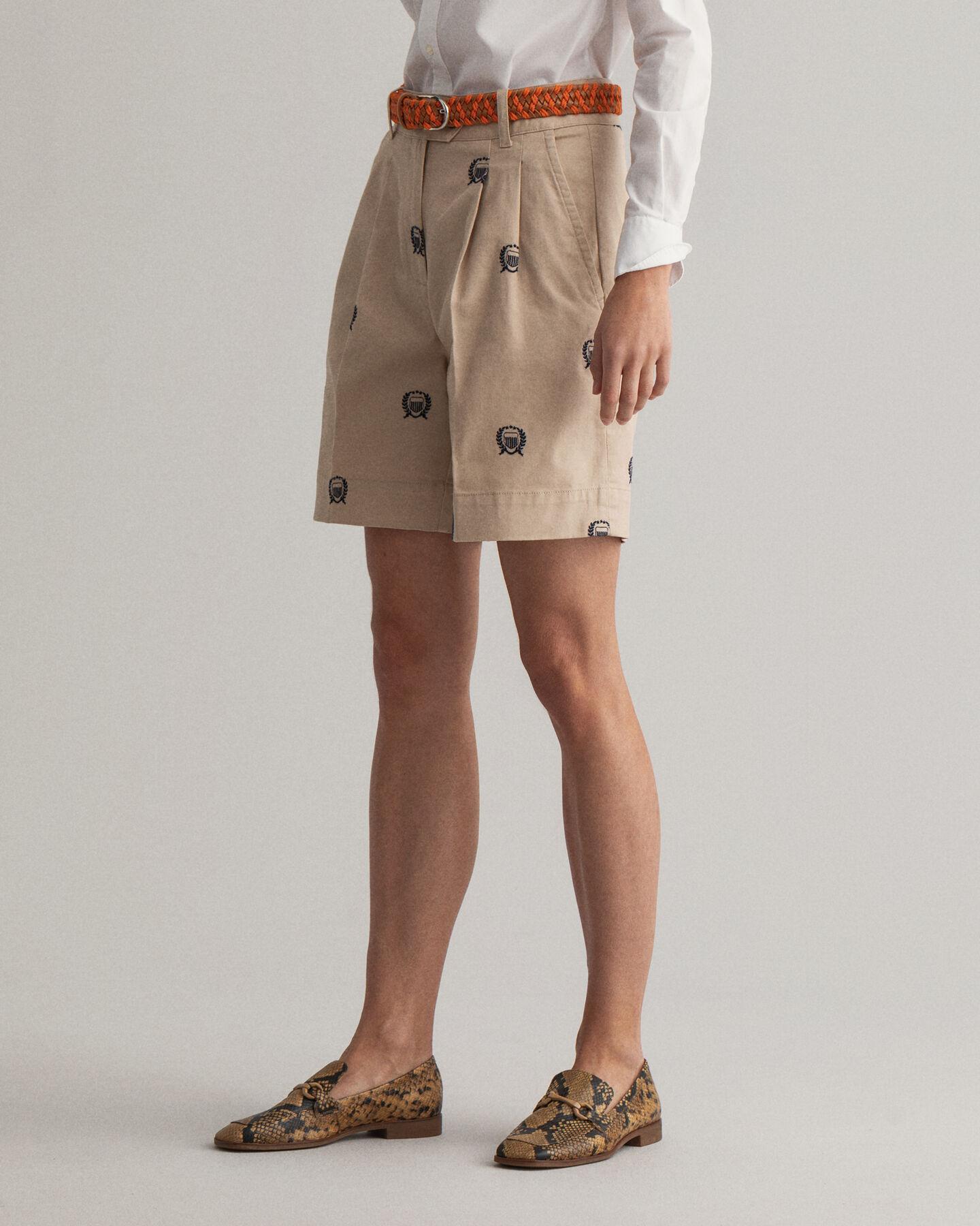 Crest shorts med hög midja, veck och broderier
